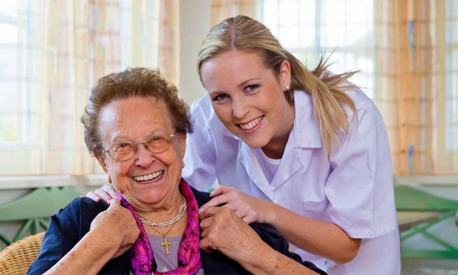 nurse comforting elderly woman